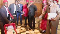 Why are Uganda's MPs smashing plates?