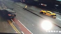 Luxury sports car crashes into people carrier