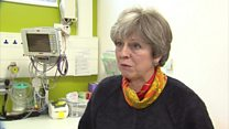 Theresa May sorry for NHS difficulties