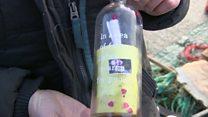 Racy message in bottle in coast litter