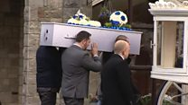 Dead boy's twin rides on funeral carriage