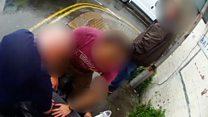 Footage shows 'drugs-in-mouth' arrest
