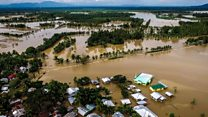 Rescuers search for Storm Tembin victims