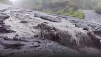Volcanic mudflows sweep away roads