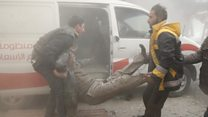 Rescuers help wounded after Syria raids