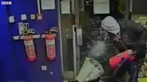 Service station robber trapped by staff
