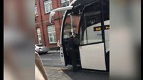 Woman 'pushed' off coach by driver