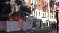Firefighters battle building site blaze