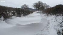Car hidden in giant snowdrift