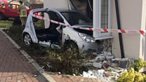 Car crashes through living room wall