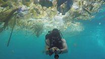 Diver films 'horrifying plastic cloud'