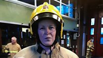 Female firefighter hangs up boots