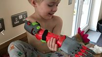 Father makes 3D printed arms for son
