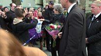 Theresa May fist bumps Salisbury woman