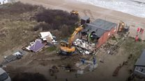 Drone shows cliff-top homes' demolition