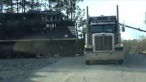 Two trains hit trucks in one US state