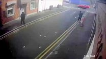 Cash flies in the wind from robber's trousers