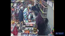 Moment shopkeeper fights off armed robber