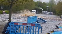 Burst water pipe submerges street