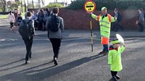 The retiring lollipop man and his helper