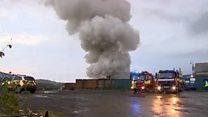 Fire burns at metal scrap yard