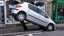 Parking fail leaves car on ticket machine