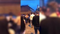 Crowd surrounds car during Newport incident