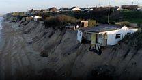 Teetering cliff-top homes demolished