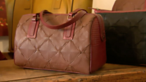 Fire hose transformed into luxury bags