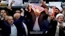 Iranian politicians burn US flag