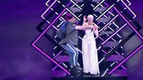 Stage invader interrupts SuRie performance