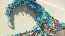 """Wave of plastic"" mural appears on seaside wall"