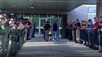 Police escort slain officer's son to school