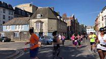 Car driven into half marathon runners