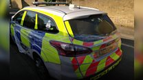 Police car wrapped in cling film