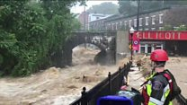 Water rages through flooded Maryland streets