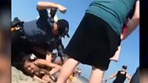 Police punch woman in US beach arrest
