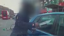 Man tries to smash car window with knife
