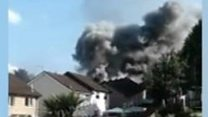 Smoke billows from house after explosion