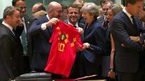 Theresa May receives a Belgium football shirt