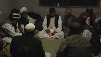 Playing cards under the Taliban's nose