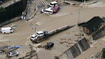 Japan towns engulfed by landslides
