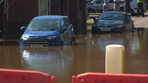 Burst water main floods homes and wrecks road