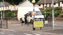 Petrol bomb thrown at moving van