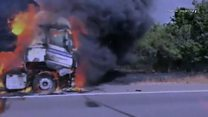 Lorry engulfed in flames on motorway