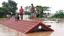 Laos villagers stranded on rooftops