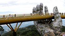 Walking in a god's hands on Vietnam bridge