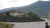 Mudslide erupts in Swiss village