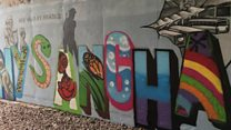 Graffiti covers racist marks in underpass