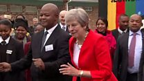 May dons her dancing shoes in SA